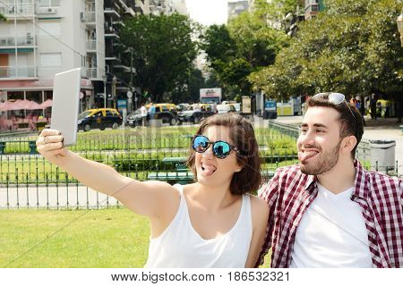 Couple Taking Selfie With Tablet.