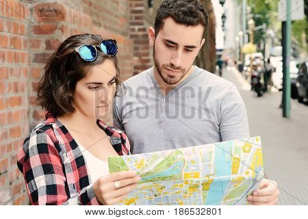 Couple Looking At The Map.