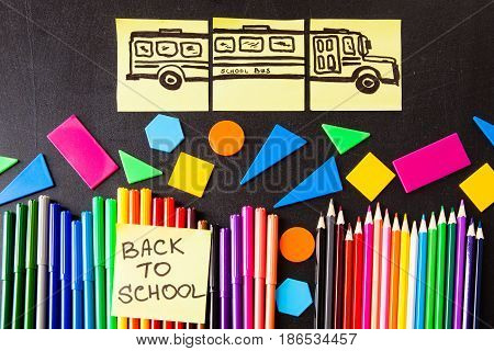 Back to school background with a lot of colorful felt-tip pens and colorful pencils titles