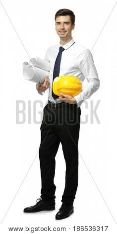 Young engineer holding hard hat and blueprints on white background