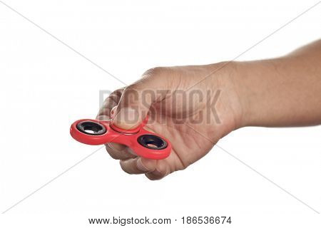 closeup of a young caucasian man playing with a red fidget spinner, on a white background
