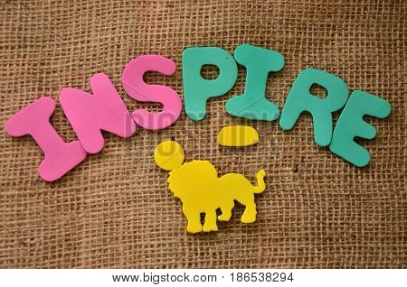 word inspire on a  abstract colorful background