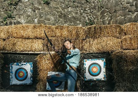 Cute Girl Archer Aiming High With Bow And Arrow