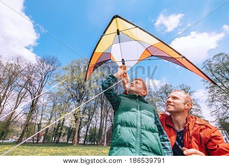 Father with son start to fly a kite