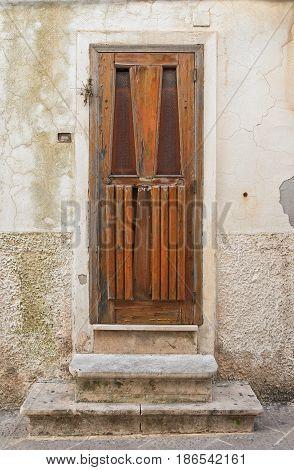 Detail of a wooden door. Noci. Puglia. Italy.