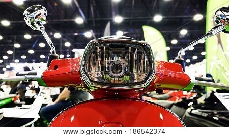 front shiny chrome motorcycle headlight close view