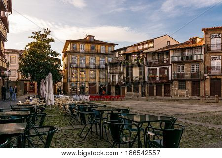Guimarães, Portugal - November 16, 2013: Empty terraces in the historical center of the city of Guimarães, square Sº Tiago, Portugal.