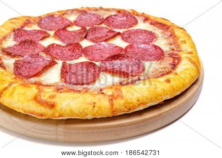 Pepperoni Pizza  on a cutting board isolated on white