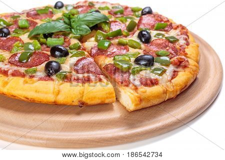 Sliced Pepperoni Pizza with Green pepper and Black Olives on a cutting board isolated on white