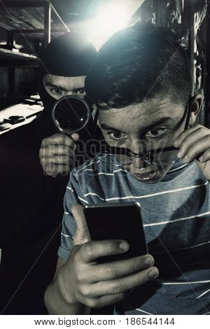 masked man spying data from smartphone of teenager
