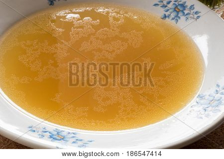 Bone Broth Made From Chicken Served In A Plate