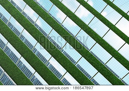 3D illustration reflection of the clouds on the photovoltaic cells. Blue solar panels on grass. Concept alternative electricity source. Eco energy, clean Energy.