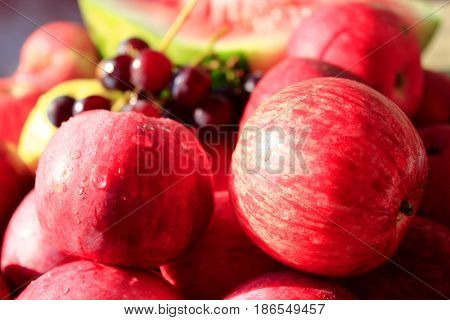 crop of August ripe fruits apples, watermelon and grape