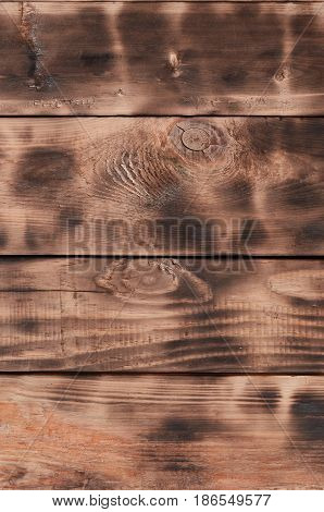 The Texture Of The Scorched Wooden Wall. Wall Of Smooth Orange Long Wooden Boards With A Specific Bl