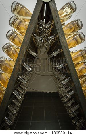 Regal with ripening sparkling wine in the wine cellar
