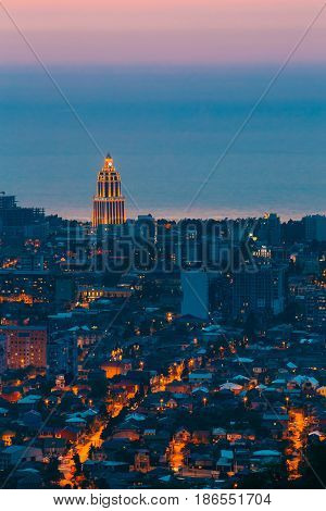 Batumi, Adjara, Georgia - May 27, 2016: Aerial View Of Urban Cityscape At Evening Or Night. Sheraton Batumi Hotel In Night Illumination