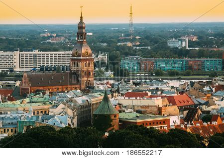 Riga, Latvia - July 2, 2016: Riga Cityscape. Top View Of Riga Dom Dome Cathedral - Famous Church And Landmark In Sunset Light Of Summer Evening. Aerial View At Sunset Time