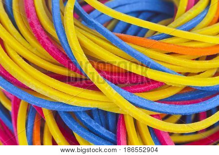 Colorful rubber bands in detail as background