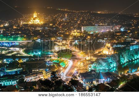 Tbilisi, Georgia. Cityscape In Night Illumination With Famous Landmarks. Rike Park, Holy Trinity Cathedral Or Sameba, Saint George Armenian Cathedral, Metekhi Church In Old Historic District