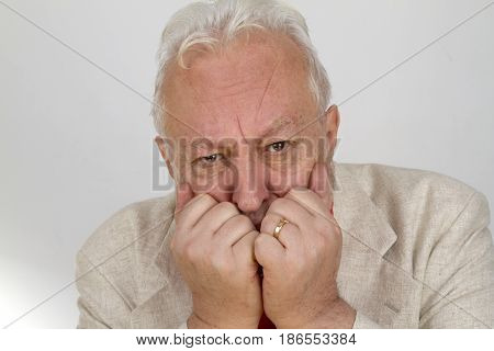 Elderly person is looking in fear - on bright background