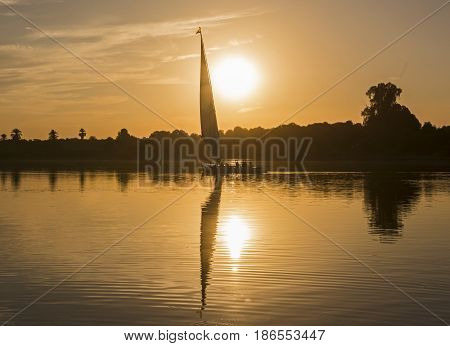 Traditional Felluca Sailing Boat Silhouette At Sunset
