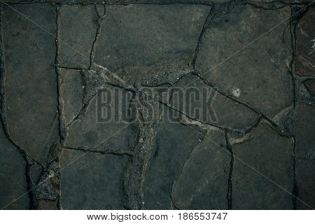 Old cobbles pattern, cobblestone texture, close up view, stone background.