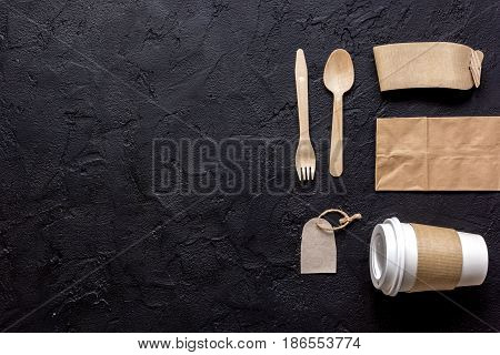 breakfast take away with paper bags on dark restourant table background top view mock up
