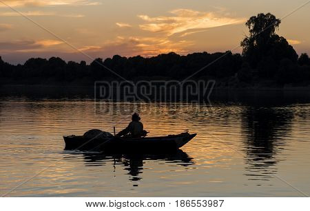 Traditional Egyptian Bedouin Fisherman Silhouette At Sunset