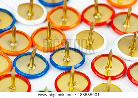 Heap of multicolored pins - abstract stationery background