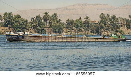 Old Traditional River Barge Traveling Through Rural Landscape