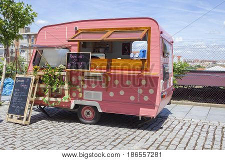 Merida Spain - May 14 2017: Pink dotted food truck at the historical city of Merida Extremadura Spain