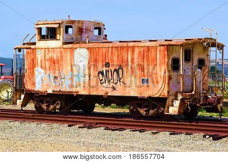 April 20, 2017 in Lompoc, CA:  Haunting image of an abandoned caboose with rust taken in Lompoc, CA where people can walk up and view a historic railroad caboose