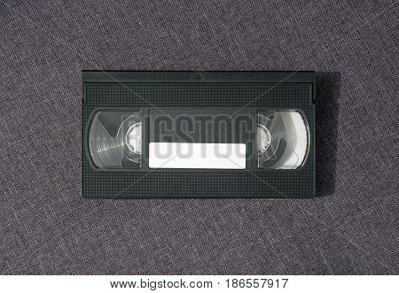 One video cassette from the front side on a gray background