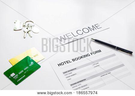 room reservation form on hotel reception desk background