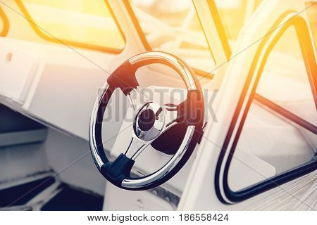 steering wheel on a luxury yacht. Concept travel on the water, the sea.