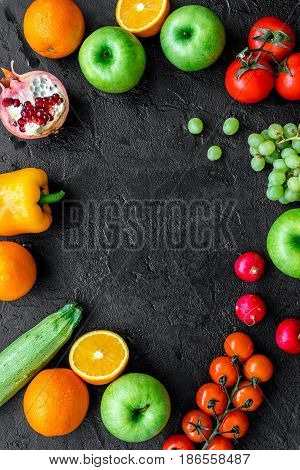diet food with fresh fruits and vegetables salad on dark background top view mockup