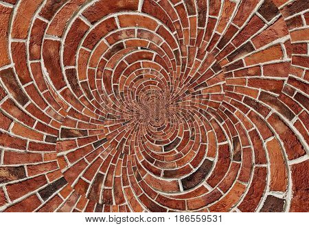 Double spiral effect abstract red brick wall texture background. Arch arc mosaic bricks wall terracotta colors. Red bricks wall spiral mosaic. Traditional red bricks gray white concrete Pattern wall