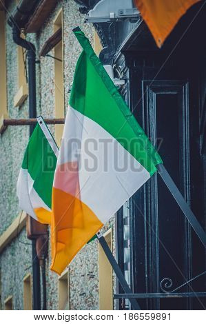 Flag of the Republic of Ireland on the wall of a building