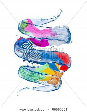 Colorful clothes rotates in a whirlpool of water isolated on white background