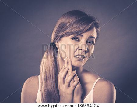 Woman Suffering From Tooth Pain