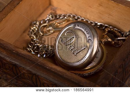 Dad's pocket watch in a wooden box
