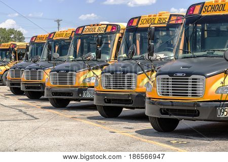 Cincinnati - Circa May 2017: Yellow School Buses in a District Lot Waiting to Depart for Students I