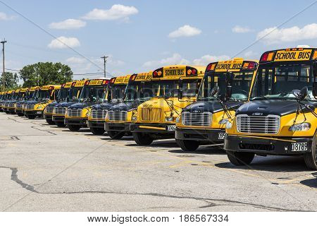 Cincinnati - Circa May 2017: Yellow School Buses in a District Lot Waiting to Depart for Students V
