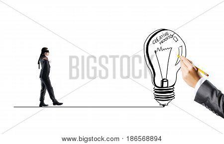Young businessman walking forward to idea on drawn line