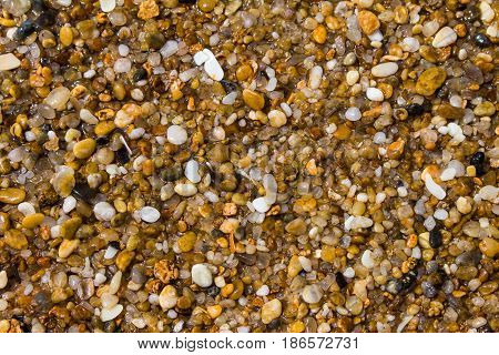 Abstract texture backgraund of small natural stones for designers.