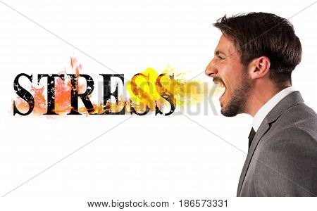Businessman burns the word stress. stressed business life concept