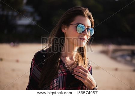 Close up beach portrait of cheerful blonde hipster. Wild girl on summer beach with sunglasses, hipster girl style, trendy.