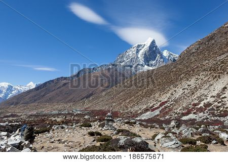 Beautiful Himalayan Landscape With Mountain Peak On The Horizon And Barberry Shrubs In The Mountain