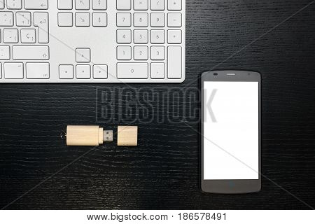 Flash Memory And Mobile With Dark Background On A Wooden Board