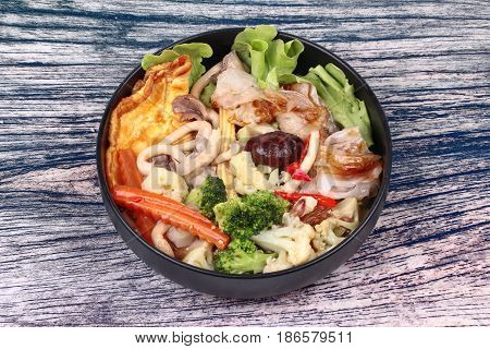 Fried Big Noodle  With Omelet Topped Mixed Vegetable In Soup.